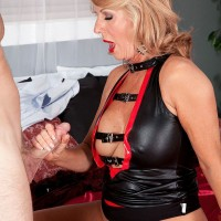 Sexy over 60 granny Phoenix Skye tugging and sucking on younger cock
