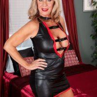 Leggy over 60 blonde escort Phoenix Skye giving client oral sex in red high heels