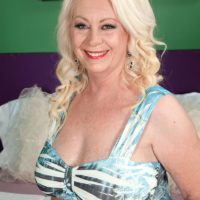 Hot over 60 MILF Angelique DuBois and her pierced nipples giving bj
