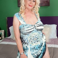 Curvy blonde MILF over 60 Angelique DuBois baring huge hangers before giving bj