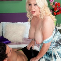 Blonde granny over sixty Angelique DuBois flashing big 60 plus MILF boobs