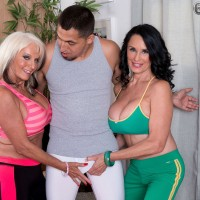 Over 60 MILF lesbian lovers Sally D'Angelo and Rita Daniels kissing in yoga pants