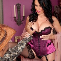 Stocking and lingerie clad over 60 MILF Rita Daniels giving big cock a blowjob