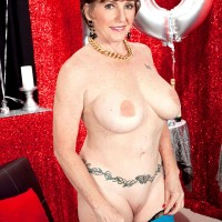 Stocking clad mature birthday girl unveiling nice, large, all natural granny tits
