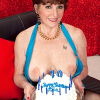 Mature MILF with red hair changes into sexy lingerie on her 70th birthday
