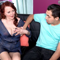 Bosomy granny with red hair getting it on doggystyle with younger man on couch