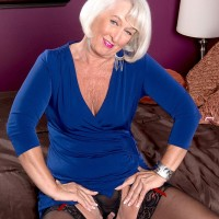 Clothed granny Jeannie Lou having big tits and erect nipples exposed in stockings
