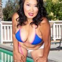 60 plus Asian MILF Mandy Thai takes off a swimsuit to get totally naked by a swimming pool