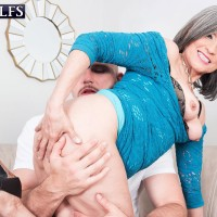 60 plus grandmother Kokie Del Coco entices a younger stud in a short dress