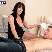 60 plus MILF Christina Starr entices a young man after discarding a black dress