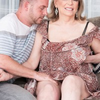 Aged doll Crystal King has her large titties played with by a younger stud