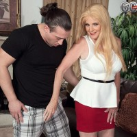 Aged golden-haired dame Charlie has her big tits unveiled by younger guy in a crimson miniskirt