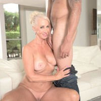 Aged sandy-haired porno star Madison Milstar exposing humungous breasts and upskirt panties