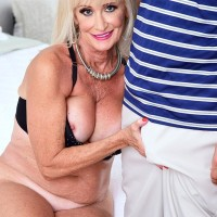 Alluring grannie Leah L'Amour deep throats and bangs a hefty penis while her hubby sleeps