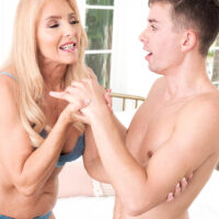 Alluring yellow-haired grannie Chery Leigh flashes a younger guy while seducing him