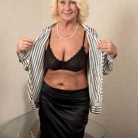 Ash-blonde grannie Regi letting floppy free from brassiere before lube massage from massagist