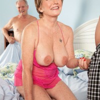 Big-boobed red-haired grannie Bea Cummins stroking off monster-sized wood while cuck spouse sleeps
