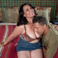 Big-chested over 60 black-haired MILF Rochelle Enticing freeing large hooters for nipple play