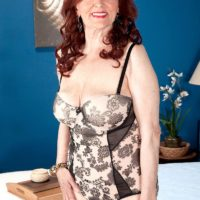 Big-chested red-haired grandmother Katherine Merlot giving massive cock blow-job in hose