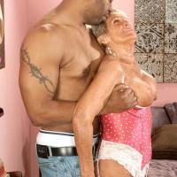Big-titted stocking and lingerie clad Seventy plus grandma Sandra Ann delivering large ebony prick a blowjob
