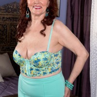 Bosomy ginger-haired MILF over Sixty Katherine Merlot delivering huge wood breastjob in nylons