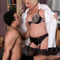Busty blond Sixty plus MILF Scarlet Andrews having erect nipples fellated and taunted