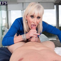 Sexy 60 plus MILF Leah L'Amour entices a younger dude in the sauna before delivering ORAL SEX