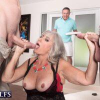 Elderly doll Silva Foxx gives 2 studs blow-job in front of her cuckold husband