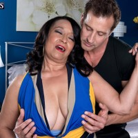 Experienced black-haired broad Rochelle Sweet unveiling hefty all natural melons for nipple sucking