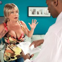 Fair-haired grandma Lexi McCain whipping out gigantic breasts before providing big black dick oral job