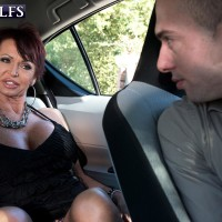 Fashionable aged broad Gina Milano tempts a younger man with her large tits