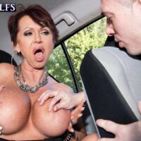 Fashionable older lady Gina Milano seduces a junior dude with her large boobs
