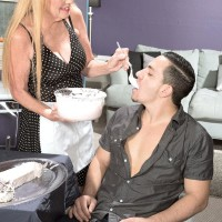 Fully clothed fair-haired over 60 MILF Charlie delivering CFNM hand job to large penis