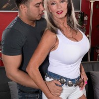 Gangly Sixty plus MILF Sally D'Angelo freeing large older melons before stroking penis