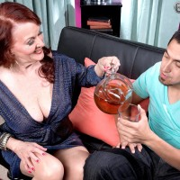 Ginger-haired grandmother Katherine Merlot exposing big natural tits to entice sex