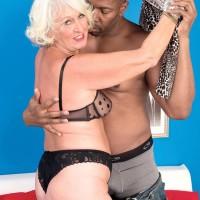 Golden-haired grandma Jeannie Lou providing monster-sized ebony wood bi-racial oral sex in lingerie