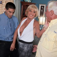 Golden-haired grandma Scarlet Andrews uncovering humungous knockers before cuck spouse