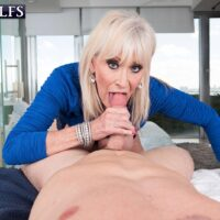 Horny sixty plus MILF Leah L'Amour seduces a junior boy in the sauna before delivering giving him head