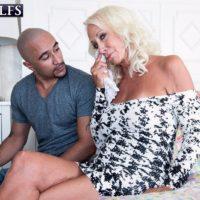 Super-sexy 60 plus MILF Madison Milstar entices an ebony boy in a clingy dress