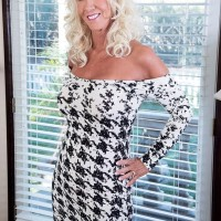 Beguiling 60 plus MILF Madison Milstar tempts a younger ebony stud in a tight fitting sundress