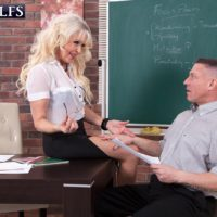 Experienced lecturer Doll S seduces a masculine student in a dark skirt and glasses
