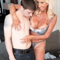 Seductive over sixty MILF Madison Milstar tempts a junior dude in her brassiere and panties