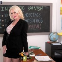 Huge-boobed ash-blonde sixty plus MILF instructor Angelique DuBois stroking large dick in classroom