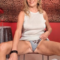 Huge-boobed fair-haired older lady Bethany James flaunting monster-sized juggs and upskirt panties