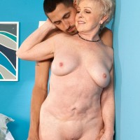 Huge-boobed granny Jewel having bare buttocks and vagina blown by younger stud