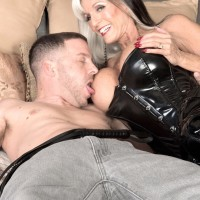 Huge jugged Sixty plus MILF Sally D'Angelo milks a rod in spandex boots and black corset