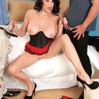 Leggy older XXX flick starlet Rita Daniels providing two cocks oral sex in MMF 3 way