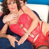 Lingerie attired dark haired grandma Jacqueline Jolie exposing huge melons for nip eating
