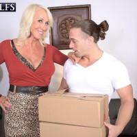 Mature fair-haired adult video starlet Madison Milstar revealing hefty natural boobies before xxx sex
