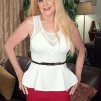 Elder blond broad Charlie has her large tits unsheathed by a junior stud in a pretty crimson skirt